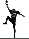 American football player man catching receiving silhouette. One caucasian american football player man catching receiving in silhouette studio isolated on white Stock Images