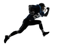 American football player man running  silhouette. One caucasian american football player man running   in silhouette studio isolated on white background Royalty Free Stock Image