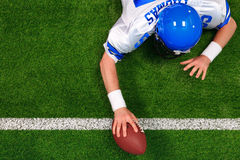 American football player one handed touchdown. Overhead photo of an American football player making a one handed touchdown. The uniform he's wearing is one I had stock photos
