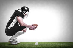 American football player. American football player on the football pitch Royalty Free Stock Photos