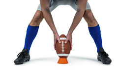 American football player placing ball between legs Royalty Free Stock Photo