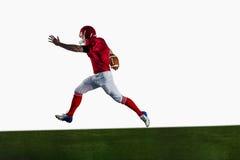 American football player playing football Stock Image
