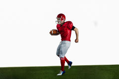 American football player playing football Stock Images
