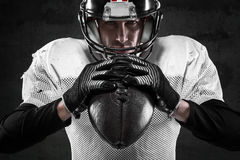 American football player. Portrait of american football player on dark background Stock Images