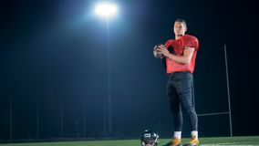American football player posing on a field, close up. stock video