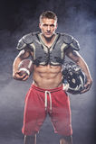 American football player posing. In studio Royalty Free Stock Photography