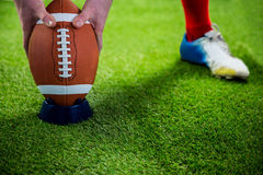 American football player preparing for a drop kick Royalty Free Stock Photo