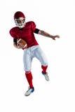 American football player protecting football Stock Image