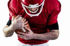 American football player protecting football Royalty Free Stock Photos