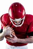 American football player protecting football Royalty Free Stock Image