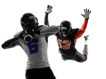 American football player quarterback sacked silhouette. Two american football players quarterback sacked in silhouette shadow on white background Stock Photos