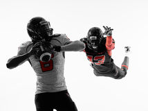 American football player quarterback sacked. Two american football players quarterback sacked in silhouette shadow on white background Royalty Free Stock Photography