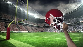 American football player raising his helmet stock footage