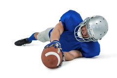 American football player reaching ball. Against white background stock photos