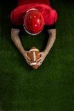 American football player reaching football Royalty Free Stock Image