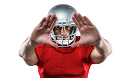 American football player in red jersey defending. Portrait American football player in red jersey defending against white background Stock Photos
