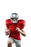 American football player in red jersey running Royalty Free Stock Photos