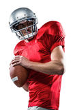 American football player in red jersey throwing the ball. On white background Stock Photo