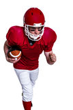 American football player running with the ball Stock Photos