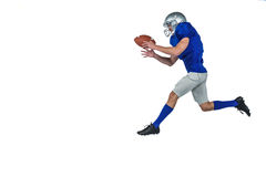 American football player running while catching ball Stock Photography