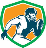 American Football Player Running Shield Retro. Illustration of an american football gridiron player holding ball running rushing viewed from the side set inside Stock Photo