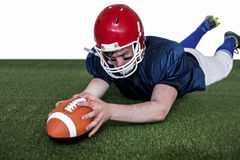 American football player scoring a touchdown Stock Images