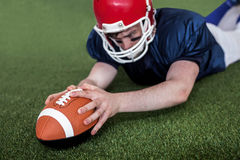 American football player scoring a touchdown Royalty Free Stock Photos
