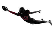 American football player scoring touchdown  silhouette Royalty Free Stock Image
