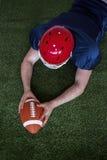 American football player scoring a touchdown Stock Photos