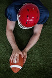 American football player scoring a touchdown Stock Image