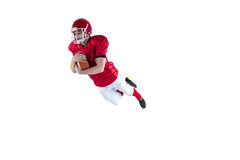 American football player scoring a touchdown. On a white background Royalty Free Stock Image