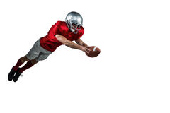 American football player scoring a touchdown. On white background Royalty Free Stock Photo