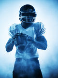 American football player silhouette. One american football player portrait in silhouette shadow on white background Stock Photos