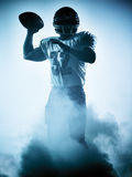 American football player silhouette. One american football player portrait in silhouette shadow on white background Royalty Free Stock Image
