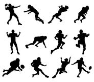 American football player silhouettes. A set of highly detailed high quality American football player silhouettes Stock Photography