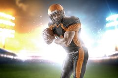American football player at the stadium in black and orange outfit stock image
