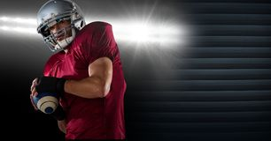 American football player with stadium lights transition. Digital composite of American football player with stadium lights transition Royalty Free Stock Photos
