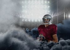 American football player in stadium with smoke. Digital composite of american football player in stadium with smoke Royalty Free Stock Image