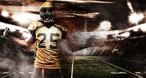 American football player, athlete in helmet on stadium in fire. Sport wallpaper with copyspace on background. stock photo