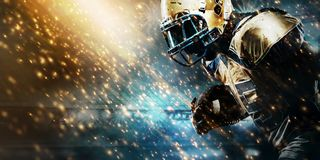 American football sportsman player on stadium running in action. Sport wallpaper with copyspace. American Football player on stadium with smoke and lights stock images