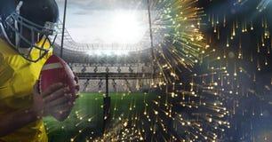 American football player with stadium transition. Digital composite of American football player with stadium transition stock photos