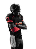 American football player standing arms crossed silhouette. One american football player standing arms crossed in silhouette shadow on white background Royalty Free Stock Photo