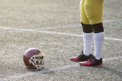 American football player standing on the field next to the sport royalty free stock photography