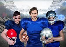 American football player standing with helmet and ball against digitally generated background Stock Photos