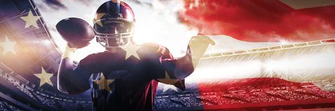 Composite image of american football player standing with helmet preparing to throw ball stock photo