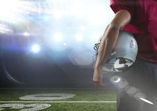 American football  player standing in stadium rear view. Digital composite of american football  player standing in stadium rear view Stock Photo