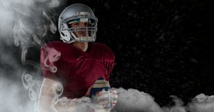 American football  player standing in stadium starting game. Digital composite of american football  player standing in stadium starting game Stock Photography