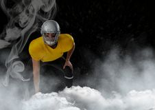 American football  player standing in stadium starting game. Digital composite of american football  player standing in stadium starting game Stock Images