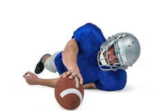 American football player struggling to catch the ball Royalty Free Stock Photo