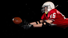 American Football Player. Studio shot over black Royalty Free Stock Photography